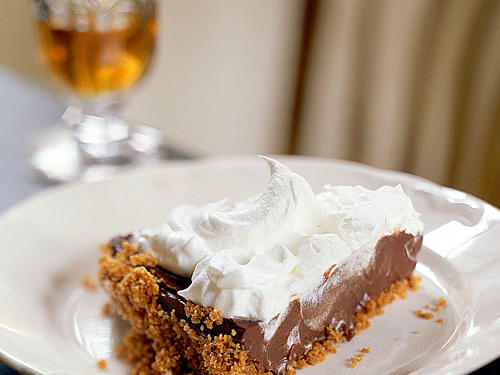 This lightened version of classic chocolate cream pie features a smooth, rich chocolate filling and a creamy topping, but has only 8 grams of fat per serving.
