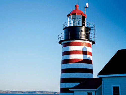 Built in 1858, West Quoddy Head Light, near Lubec, stands on the           easternmost point of the continental United States. Whales can           sometimes be seen offshore, and bald eagles nest in the area.