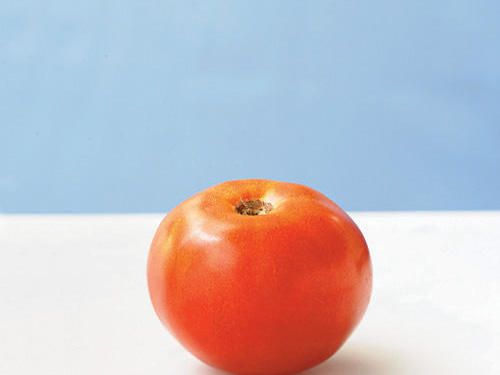This dark red globe tomato is juicy and meaty with a robust flavor similar to ketchup, but slightly less sweet.
