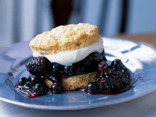 The key to tender low-fat shortcakes is to not overwork the dough; so pat it out instead of rolling it. A portion of the blueberries is cooked with sugar and cornstarch to form a blueberry glaze that binds the filling. This dessert is best with fresh berries.