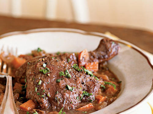Although traditionally made with an older bird, this French braise is great with supermarket chicken. You can purchase a whole chicken and cut it up (or have the butcher do so), or start with bone-in parts. Meat on the bone offers more flavor than boneless meat and holds up best in braises. An American pinot noir or French burgundy are tasty choices for this dish. You can serve in a bowl over mashed potatoes to soak up the sauce.