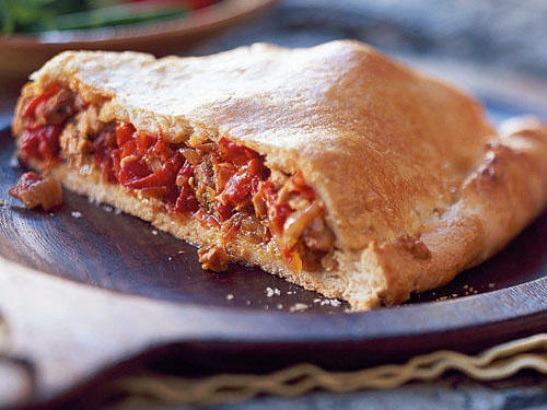 You may be more familiar with the Latin American variety, but           the savory pocket pie called the empanada originated in Galicia in           northwest Spain. This version is filled with a typical combination           of seasoned meat and tender onion and bell pepper.           View           Recipe: Empanada Gallega