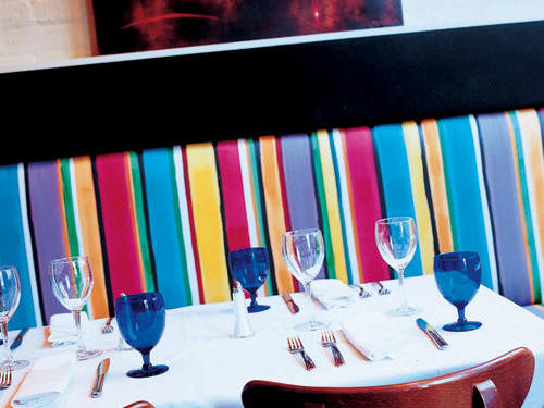 Table Set in Brightly Colored Booth