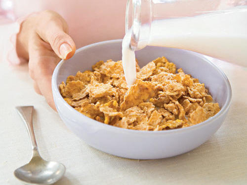Cut your current high-sugar cereal with a low sugar, high-fiber brand. Gradually reduce the amount of sugary cereal in your bowl until you are eating only the high-fiber brand. Check out our picks for The Best Healthy Cereals.