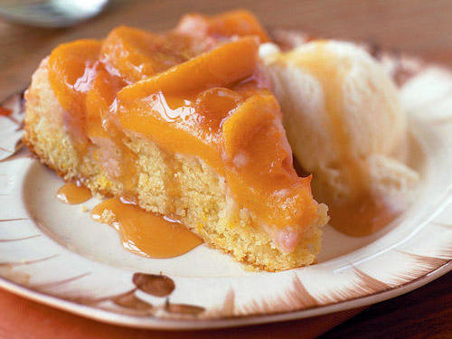 The sugar and fruit juice tossed with the peaches create a caramelized glaze as the cake bakes.