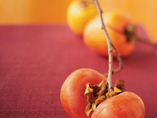 Available October through February, persimmons are sometimes compared to apricots or plums in flavor and texture, and when fully ripe have cinnamon, clove, and sweet undertones. Choose persimmons that are heavy for their size and look for fruit with glossy, firm, brightly-colored skin.Read more: All About Persimmons