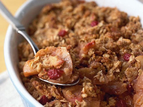 The combination of oats, whole wheat pastry flour, and walnuts makes the topping taste a little like a granola bar. This dish can be made ahead and warmed in a 250º oven while you eat dinner.