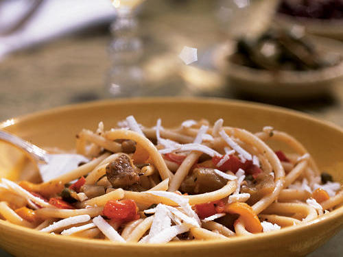 Eggplant and capers, which are among Sicily's staple ingredients, add a delectable flavor to this summery pasta sauce. If you can't find bucatini (long, hollow pasta), you can use linguine or spaghetti. Prepare the sauce up to 2 days in advance, and then reheat gently over medium-low heat while you cook the pasta.