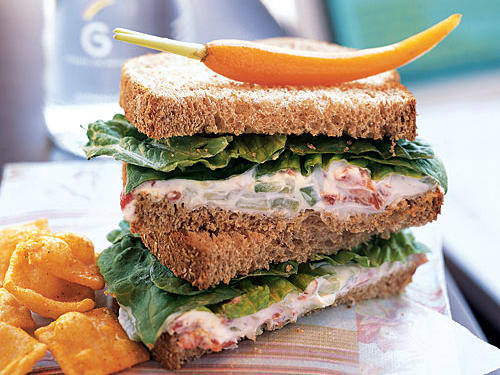 Keep the sandwiches well chilled so the cream cheese spread will remain firm. Sturdy, whole grain bread works best.