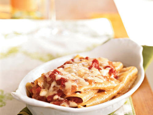 The tomato-and-bacon sauce packs a red-pepper punch, balanced by creamy melted mozzzarella in this lasagna.