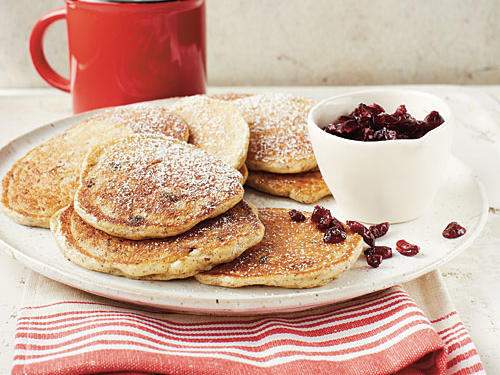 With a dusting of powdered sugar and a kick of tart cranberry, these pancakes are sure to be a welcomed surprise to your morning routine. The addition of oats not only adds fiber, it bulks up the batter for a hearty, nutty pancake. The best part? They're as easy to make as they are to eat!