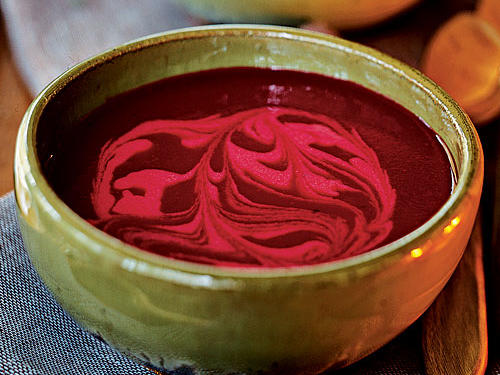 For added creaminess and a lovely presentation, we swirled this vibrantly colored beet soup with sour cream. Even without the additional decoration, the bright and vibrant color of this soup will make a dinner table show-stopper.