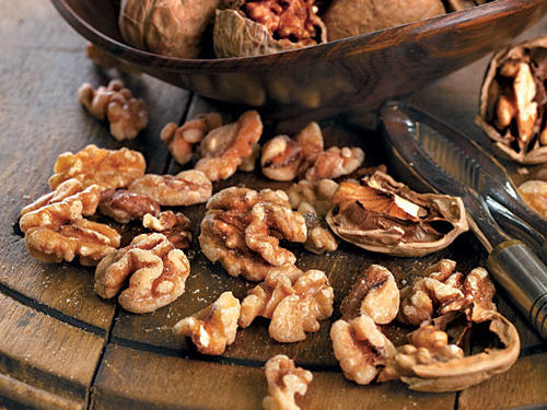 Noshing on a handful of walnuts may fight both breast cancer and osteoporosis. In one new study, just two ounces of walnuts per day helped delay development of breast cancer and slow tumor growth in mice. Speculation is antioxidants called phytosterols, already known cancer fighters, could be the culprit. Or protective benefits might come from plant based omega 3 fats (walnuts are the only nut to harbor these fats.) If it's the latter, another study finds diets rich in these same plant based omega 3s are adept at preventing excessive bone turnover which keeps bones strong and healthy.The right dose: Since nuts are calorie dense, one ounce (20 halves/185 calories) is a good place to start.Recipe: Blackberry-Peach Smoothie with Walnuts