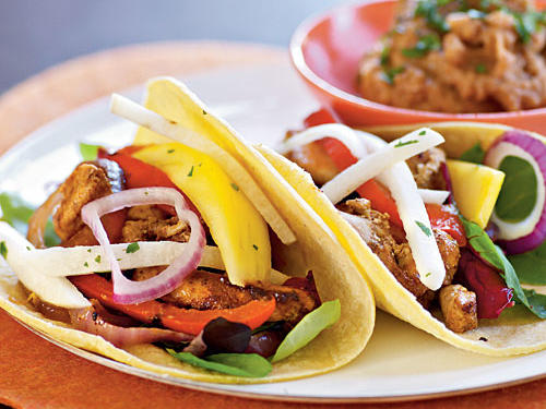 Add fresh fruits and vegetables to spicy chicken tacos for an inspired Mexican meal.