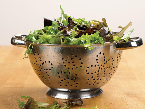 We use both metal and plastic colanders in varying sizes. A large colander works well for draining pasta and salad greens and rinsing vegetables. A small strainer is great for separating fruit juice or pulp from seeds. Mesh strainers are the most versatile because nothing can get through the holes except liquid.