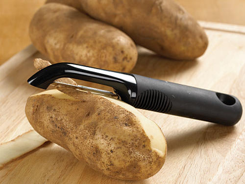 A peeler removes the skin from both vegetables and fruits. Select one with a comfortable grip and an eyer to remove potato eyes and other blemishes on vegetables and fruits. It's also handy for making Parmesan cheese shavings or chocolate curls.