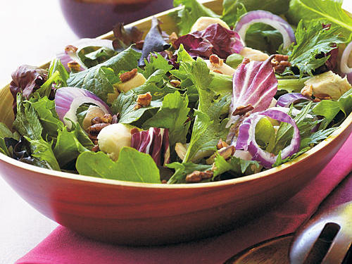 This salad is a model of nutrition. The greens and onion provide a variety of vitamins and minerals, the pecans add healthy fats, and the chicken is a great source of lean protein, all with less than 300 calories per serving. Açai dressing is rich in antioxidants, but so is any bottled berry dressing.
