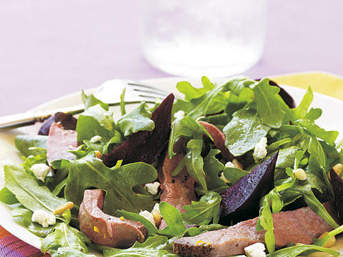 A mix of tastes and textures is key to this salad; it has sweet beets, crunchy pine nuts, bitter arugula, meaty roast beef, and creamy-and-tangy goat cheese. There's so much flavor in the salad that a quick toss with plain olive oil can replace the dressing easily.