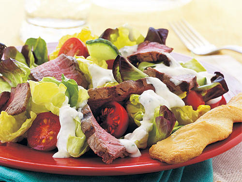 This dish combines the best parts of a steak house dinner―the simple salad with creamy dressing and the steak―into one easy meal. Since the beef will be served relatively unadorned, use the highest quality you can and don't cook it beyond medium.