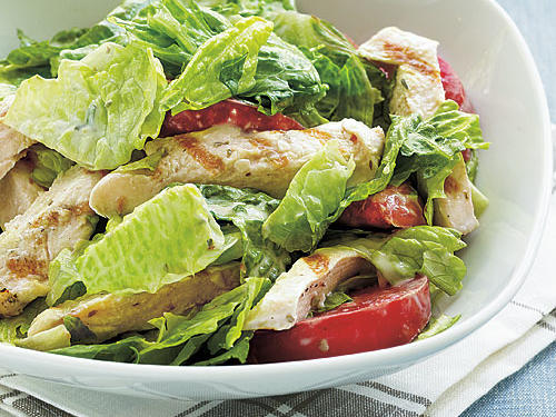 It doesn't get any more classic (or easier) than this salad. Bottled Caesar dressing is easy to find, but homemade is something everyone should try at least once. It's used here as both dressing and basting sauce for the chicken.