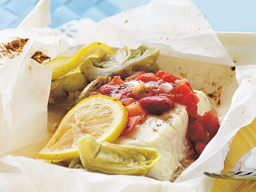 Baked in parchment paper, this dish gently steams in a chunky sauce. Serve with crusty bread for sopping up the delicate juices.