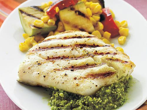 While the halibut cooks on the grill (about 8 minutes), prepare the pesto sauce. Serve with grilled zucchini and red peppers (or whatever fresh veggies you have on hand).