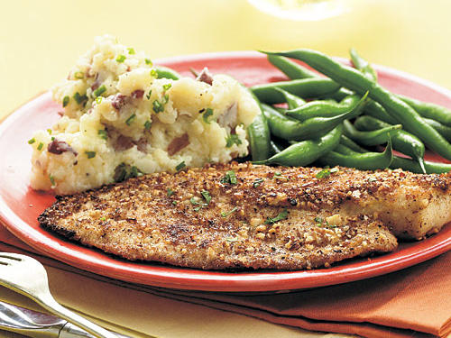 Reminiscent of a restaurant-style fish amandine, this recipe easily doubles to serve a small dinner party. Almonds add such a rich, nutty flavor to the tilapia that even the pickiest eater will think it is delicious. Serve with green beans and Mashed Red Potatoes with Chives.