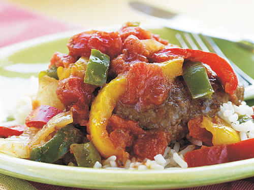 This classic American-Chinese dish is just incredibly easy. A dip in flour is the secret to nicely browned and crisp beef, and if you have fresh veggies on hand, you can use whatever you like in place of the frozen stir-fry mix.