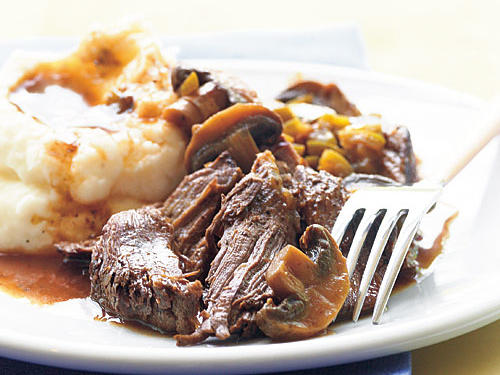 Nothing beats pot roast for a satisfying dinner on a cold day, and the slow cooker makes this recipe practically effortless. Leftovers for sandwiches are a must, so don't worry if this seems like a lot of meat.