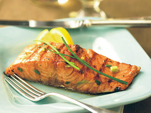 To make a complete meal, serve the salmon over a bed of brown rice, with green beans and a salad on the side. Save some orange-and-bourbon marinade and drizzle over the salmon and rice to impart complementing flavors of bourbon and citrus throughout.