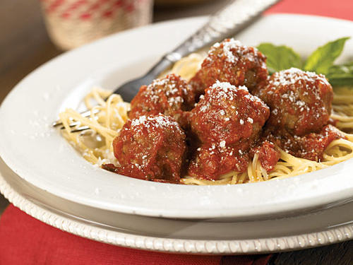 Most of the effort of this classic pasta dish goes into forming the meatballs. They're as easy as meat loaf, but quicker cooking: 6 minutes in a skillet is all it takes. Then add a jar of pasta sauce, serve over spaghetti, and sprinkle with fresh basil and shaved Parmesan.