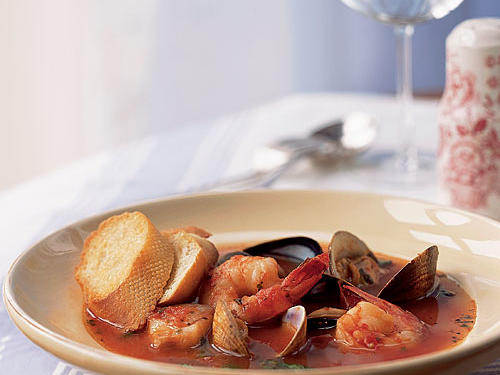 Cioppino may seem like a special-occasion meal, but it comes together quickly enough to make any weeknight a special occasion. A medley of seafood simmers in a herb-infused broth of white wine, clam juice, and pasta sauce that's perfect for dipping crusty bread.