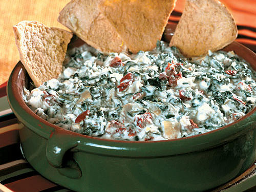 This slow-cooker spinach-artichoke dip is so rich and satisfying, you won't even know that it's low in fat and calories, too!