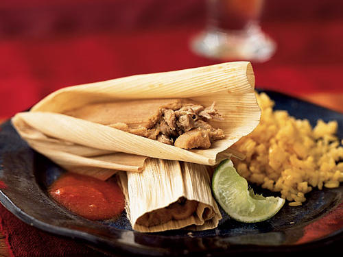 For ease, make the pork mixture for these tamales a day or two ahead. The recipe makes quite a few servings; serve with Spanish saffron-flavored rice for a fun evening with friends.