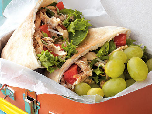 A smart trick to this zesty sandwich is using oil from the sun-dried tomatoes to prepare the vinaigrette. Prepare the chicken filling ahead of time and pack separately. Fill pitas just before eating.