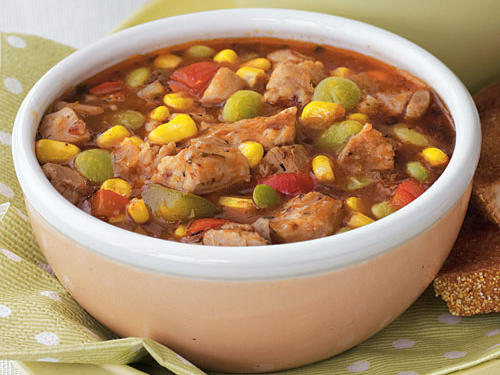 Brunswick stew is a classic Southern dish featuring meat, chopped bell pepper, lima beans, and corn in a tomato base. Developed in 19th-century Virginia, this stew originally included squirrel meat (we opt here for chicken). Although traditional Brunswick stew is sometimes thickened with stale bread cubes, this version uses flour to give it body and features garlic bread on the side. For an on-the-go lunch, you may want to substitute whole-grain crackers for the bread. Garnish with fresh thyme sprigs.