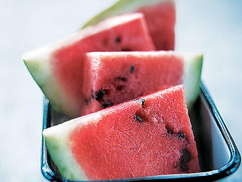 "You can find fresh watermelons between May and September, but they are at their peak from mid-June to late August. To select, choose a firm, symmetrical, unblemished melon with a dull rind, without cracks or soft spots, that barely yields to pressure. Some people swear by the ""thump"" test, but experts say that method is unreliable for determining ripeness. Rather, look for a pale yellow patch, indicating where the watermelon sat on the ground while ripening on the vine.Recipes: • Watermelon Margaritas• Summer Pea, Watermelon, and Farro Salad • Watermelon-Jalapeno Ice Pops • Marinated Grilled Chicken Breast with Watermelon-Jalapeño Salsa • Flank Steak with Grilled Mango and Watermelon ChutneySee More: All About Melons"
