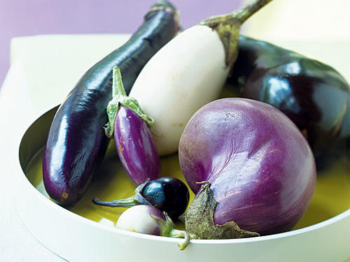 Store eggplant on the countertop—not in the refrigerator. Choose a spot that's away from direct sunlight. Choose a container that allows for circulation, like a vented bowl or perforated bag. Peeling a standard globe or Japanese eggplant is optional. Leave the skin intact for contrast, or remove it for a paler look.Recipes: • Grilled Eggplant Sandwiches with Red Onion and Aioli• Falafel-Stuffed Eggplant with Tahini Sauce and Tomato Relish • Cheesy Brown Rice Gratin with Zucchini and Eggplant • Turkey Burgers with Roasted Eggplant • Eggplant Crostini