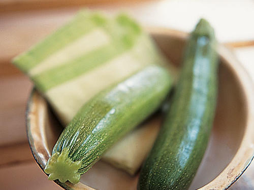 Summer is the perfect time to savor just-harvested zucchini. It's peak season is June through late August, but you may see zucchini in markets in some regions year-round. With its slightly curved cylinder-like shape, this green summer squash is perfect for blending with other ingredients or in simple preparations highlighting the taste of fresh herbs. Because zucchini has a high water content, it doesn't require much cooking; raw, it adds nice texture to a salad of greens or a crudités plate. Like its yellow summer squash counterpart, zucchini is also a good source of vitamins A and C, and fiber.Recipes: • Persian Rice-Stuffed Zucchini with Pistachios and Dill • Zucchini Angel Hair Pancake • Grilled Zucchini with Sea Salt• Stuffed Zucchini with Cheesy Breadcrumbs• Zucchini Eggplant LasagnaSee More: Use Your Zucchini