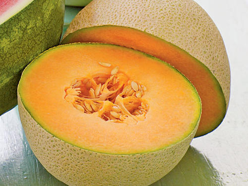It's both. The names are used interchangeably; it has khaki-colored netted rind and pale-orange flesh. Muskmelon is also a category, though, which include cantaloupes, melons with netted rinds, and some smooth-skinned melons, like honeydew.