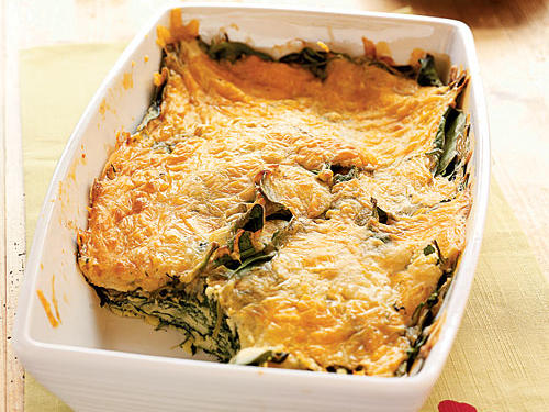 You can assemble the spinach and cheese casserole in less than 10 minutes by using preshredded cheeses. The casserole's spinach, cheese, and nutmeg ingredient combination produces a rich layer of flavor that everyone will love.