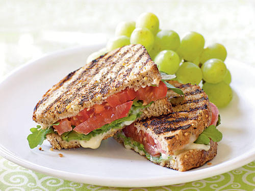 These sandwiches make the most of juicy, flavorful summer tomatoes. Serve them with grapes or carrot sticks.