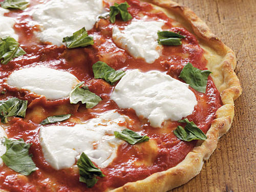 Because this classic Neapolitan-style pizza is so simple, it depends on quality ingredients. Use the best fresh mozzarella and basil you can find.