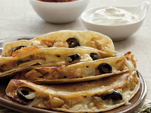 Olives may be an unexpected quesadilla filing but, we assure you, these quesadillas will be a hit.*Remember to check for gluten in corn tortillas and fresh salsa.