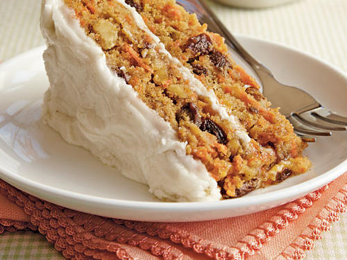 This deliciously moist cake is chock-full of carrots, nuts, and raisins.