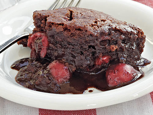 This gluten-free dessert separates into two layers as it bakes, a tender chocolate spongelike cake and a rich chocolate-cherry sauce, creating a warm and gooey texture.