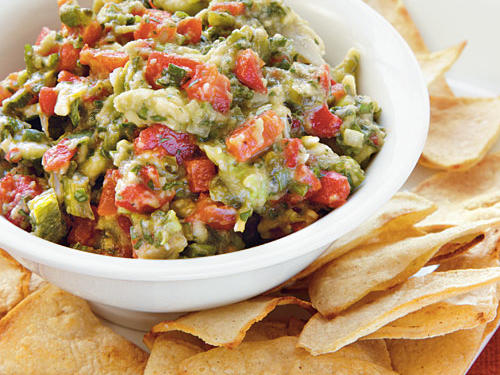 You can use this guacamole liven up a turkey sandwich or as a condiment in a vegetable wrap. If time is tight, simply serve it with store-bought baked tortilla chips. When storing, press plastic wrap against the surface to help keep it from oxidizing and turning brown.
