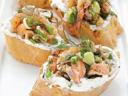 You can prepare the salmon topping earlier in the day and keep it refrigerated until ready to assemble. These appetizers look great assembled like canapés. Serve these immediately after toasting and assembling since gluten-free bread can toughen quickly if left out after heating or toasting.