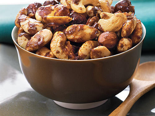 This simple recipe makes a tasty party snack. Use your favorite nuts, and add a bit of heat with a dash of ground red pepper, if you like.
