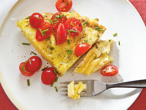 This hearty, open-faced omelet, called a tortilla, uses potatoes inside instead of serving them on the side. This omelet maximizes flavor with Yukon Gold potatoes, fresh tomatoes, and Manchego cheese.